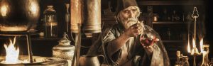Medieval alchemist in his laboratory